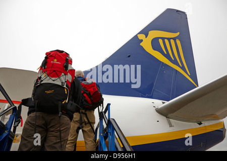 passengers with baggage boarding ryanair flight at dublin airport terminal 1 ireland - Stock Photo