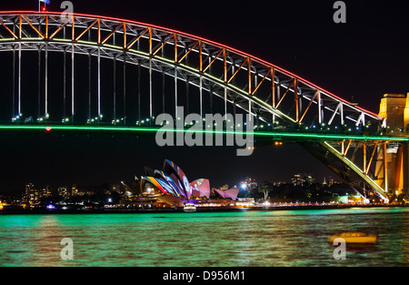 Sydney Harbour Bridge and Sydney Opera House at night during the annual Sydney Lighting Festival Vivid - Stock Photo