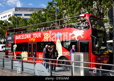tourists boarding open top city tours barcelona catalonia spain - Stock Photo