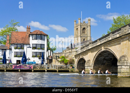 Rowers passing the Angel pub by Henley bridge over the River Thames Henley on Thames Oxfordshire England UK GB EU - Stock Photo