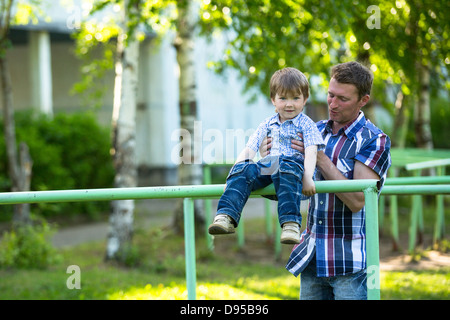 Father and son on the playground - Stock Photo