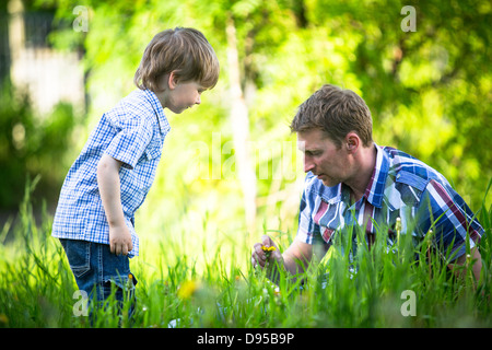 Father and son playing in the park. - Stock Photo