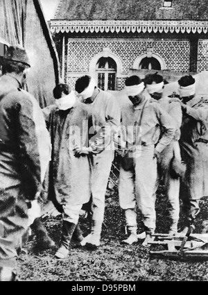 World War I  - American prisoners of war, victims of German gas attacks. Bandaged eyes are not blindfolded but have - Stock Photo