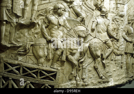 Roman cavalry crossing a wooden bridge: from Trajan's column. Erected by emperor Trajan 106-113 and carved in low - Stock Photo