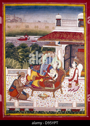 Indian miniature showing Krishna, winged attendant, and monkey god at his feet. Krishna (The Black One), an avatar - Stock Photo