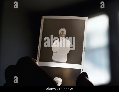 holding medium format negative bw film - Stock Photo