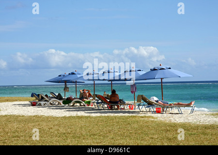beach scene at Flic en Flac on the west coast of Mauritius - Stock Photo