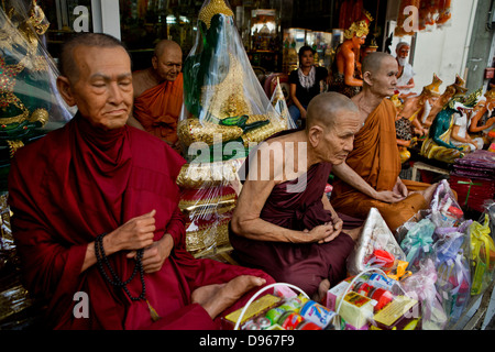 Waxwork statues of revered Buddhist figures for sale, Bangkok, Thailand - Stock Photo
