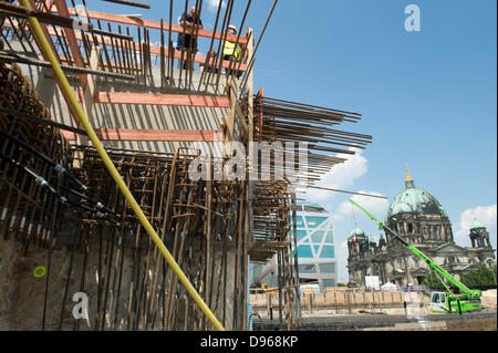 Construction site workers watch the laying of the first stone for the Berlin Palace in Berlin, Germany, 12 June - Stock Photo