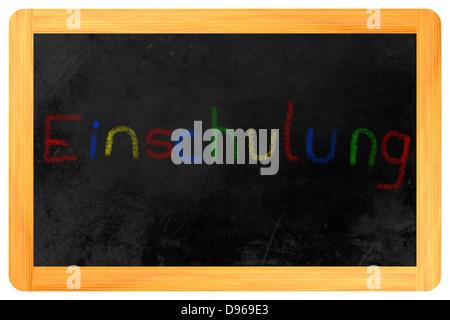 Einschulung (German: my first day at school) written on a blackboard - Stock Photo