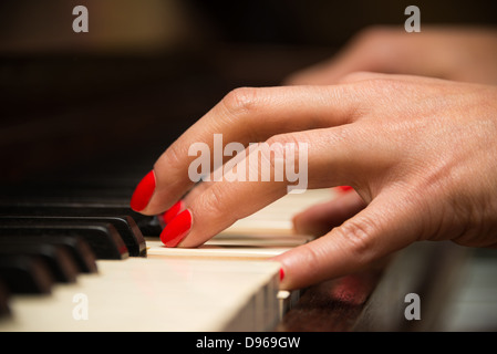 Female pianist hands closeup and piano keyboard - Stock Photo