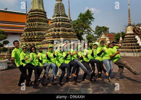 Muslim workers from an insurance company all dressed in branded Tshirts pose for a group shot inside the temple - Stock Photo