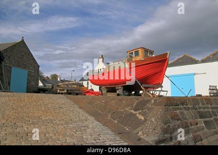 Partly Renovated Fishing Trawler in Dry Dock, Johnshaven, Aberdeenshire, Scotland, UK - Stock Photo