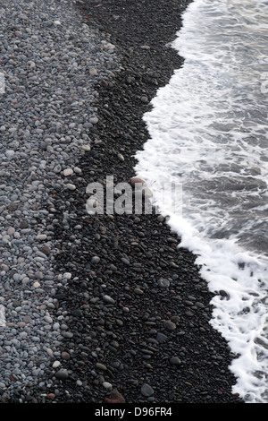 The volcanic beach on the French island of Reunion in the Indian Ocean. - Stock Photo