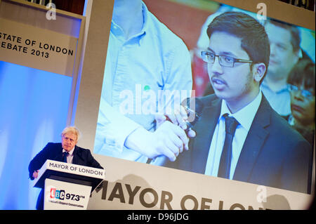 London, UK. 12th June 2013. The Mayor of London Boris Johnson listens to a question by a young boy about EDL  at - Stock Photo