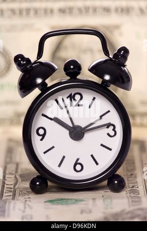 alarm clock on a one dollar bill - Stock Photo
