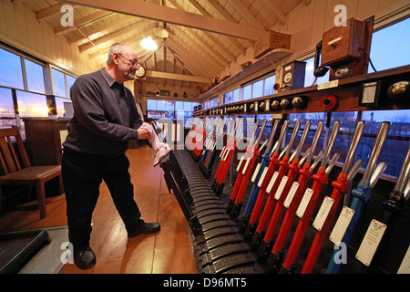 Evening with the levers in the signalbox, Crewe, - Stock Photo