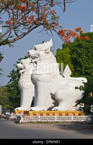 Giant CHINLES (half lion half dragon) gaurd the southwest entrance to MANDALAY HILL - MANDALAY, MYANMAR - Stock Photo