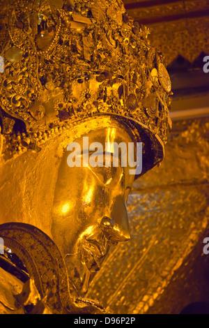The much venerated MAHAMUNI BUDDHI inside the MAHAMUNI PAYA built by King Bodwpaya in 1784 - MANDALAY, MYANMAR - Stock Photo