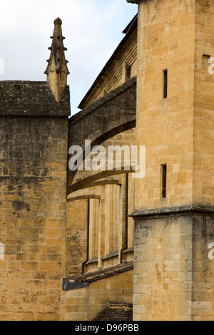 Flying buttresses made of sandstone on Saint-Sacerdos Cathedral in Sarlat, Dordogne region of France - Stock Photo