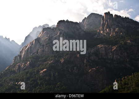 The rocky peaks of the Aiguilles de Bavella in the southern Alta Rocca region of Corsica, France. - Stock Photo