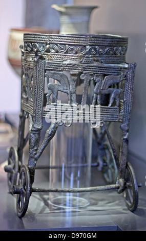 Wheeled iron wagon built for a cauldron 12-11 th century BC from Larnaka Cyprus, Greek.