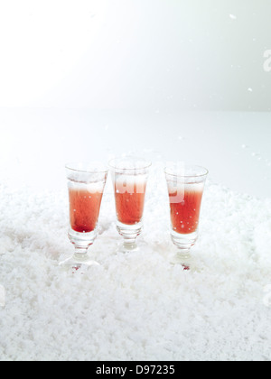 Short drink on ice against white background - Stock Photo