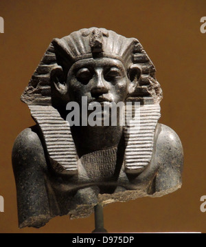 Head of a statue of King Amenemhet 111with king's head-cloth,12th Dynasty about 1840 BC. Granite - Stock Photo