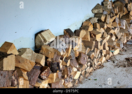 Stock of chopped wood ready for the wood burner - Stock Photo