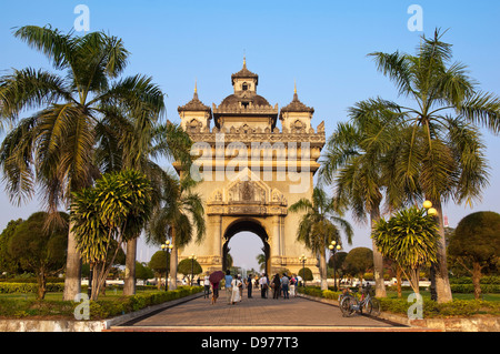 Horizontal view of the Victory Gate or Patuxai in central Vientiane on a sunny day. - Stock Photo