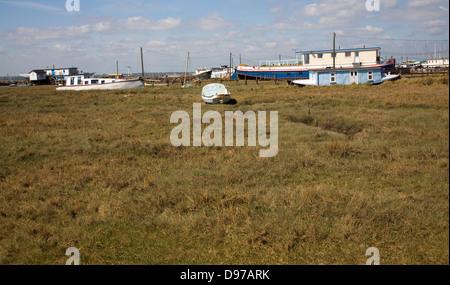 Boats on saltings West Mersea, Mersea Island, Essex, England - Stock Photo