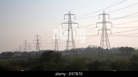 Pylons carrying high voltage electricity transmission cables across the countryside, Burgh, Suffolk, England - Stock Photo