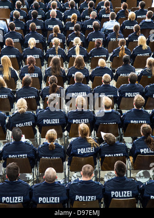 Police Commissioner candidates, trainees at the GermanPolice, sitting at a meeting in the auditorium. - Stock Photo