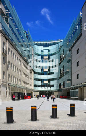 Security bollards across entrance to BBC Broadcasting House courtyard - Stock Photo