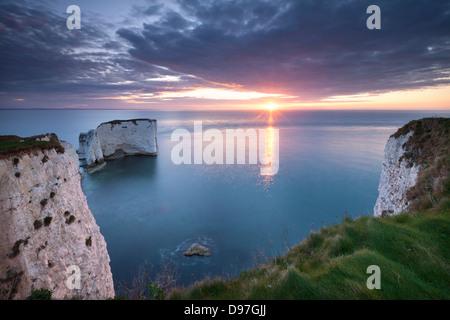 Sunrise over Old Harry Rocks, Jurassic Coast, Dorset, England. Spring (April) 2012. - Stock Photo