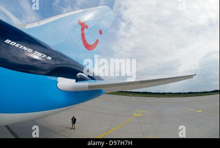 A Boeing 787 'Dreamliner' from Thomson Airways is parked on the apron as part of a pilot schooling at Hanover Aiport - Stock Photo