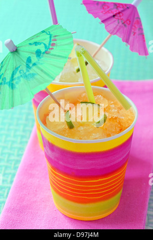 two glasses with cocktail and umbrellas shoot in studio - Stock Photo