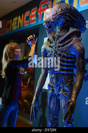 Leipzig, Germany. 13th June, 2013. A young woman films a monster as depicted in the movie 'Alien' (1979) in the - Stock Photo