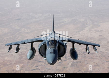 A US Marine Corps AV-8B Harrier jump jet aircraft flies on a mission June 10, 2013 over Helmand province, Afghanistan. - Stock Photo