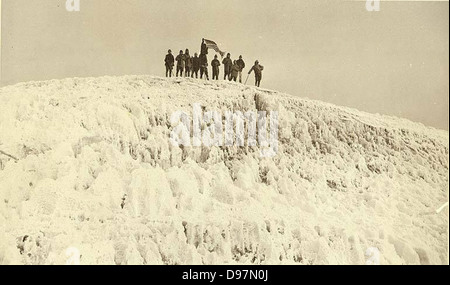 Group of mountaineers with the American flag on the summit of Mount Rainier - Stock Photo
