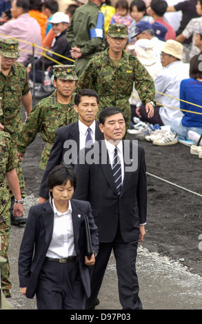 Shigeru Ishiba, Director-General of Japan's Defense Agency, (2nd L) arrives at a Japan GSDF live fire exercise in - Stock Photo