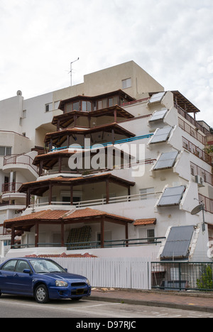 Solar panels for hot water provision in apartment building and houses of Israel - Stock Photo