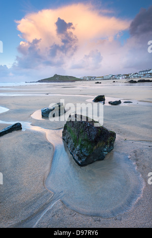 Sunset at low tide on Porthmeor Beach, St Ives, Cornwall, England. - Stock Photo