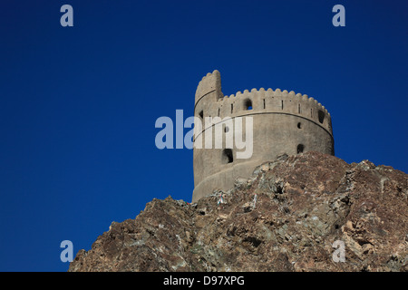 Old watch-tower about the Old Town of Muthra, Muscat, Oman - Stock Photo