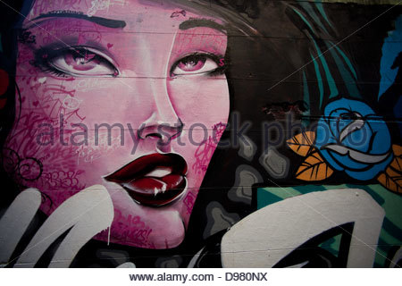 Street art lines back alleys in central Melbourne. - Stock Photo