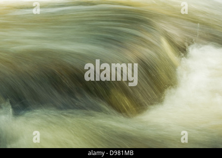 The swift waters of the River Erme  as it tumbles over the Town Falls, in Ivybridge - Stock Photo