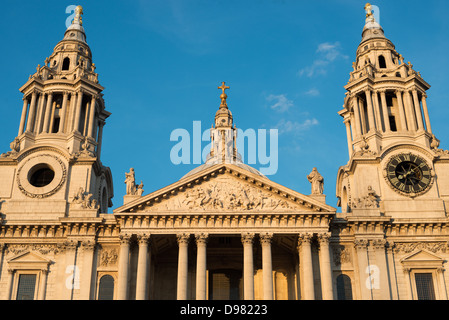 LONDON, UK - The golden light of late afternoon catches the front of St Paul's Cathedral, one of the most distinctive - Stock Photo
