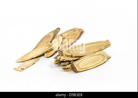 A pile of sliced, dried liquorice root on a white background. - Stock Photo