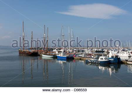 Sailing ketch and other sail boats at the deep water jetty, Brixham Harbour - Stock Photo