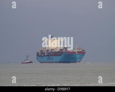 The enormous container ship Maersk Laberinto approaching the port of Rotterdam from the North Sea. - Stock Photo